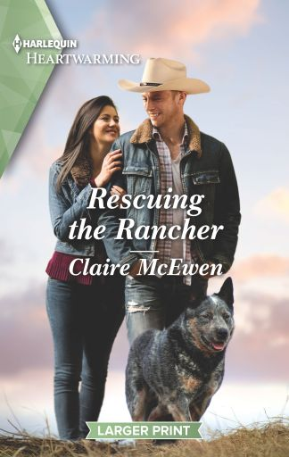A man and a woman walking outdoors with a cattle dog