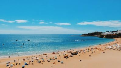 """a busy beach that clearly answers the question of """"can I travel to portugal?"""""""