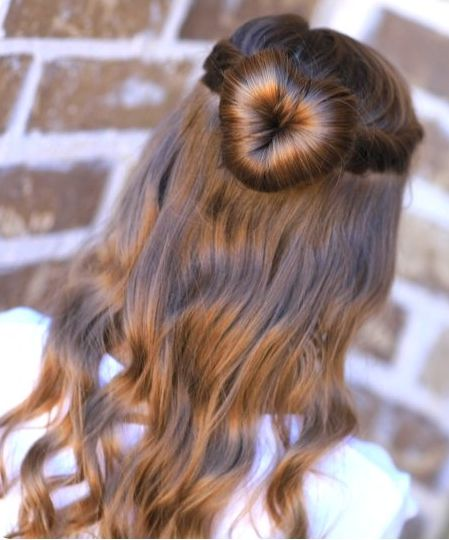 long-brown-wavy-hair-with-heart-shaped-bun-hairdo