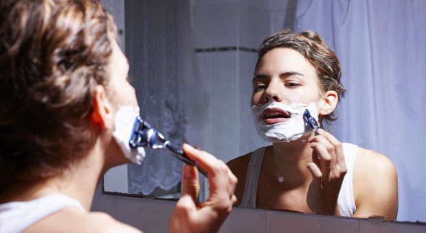woman-shaving-face