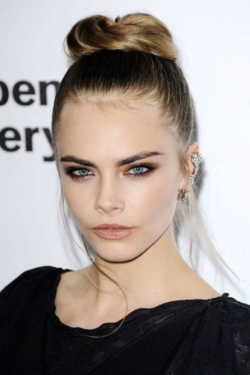 La-modella-mafia-Cara-Delevingne-red-carpet-chic-in-Chanel-with-a-bun-and-earring