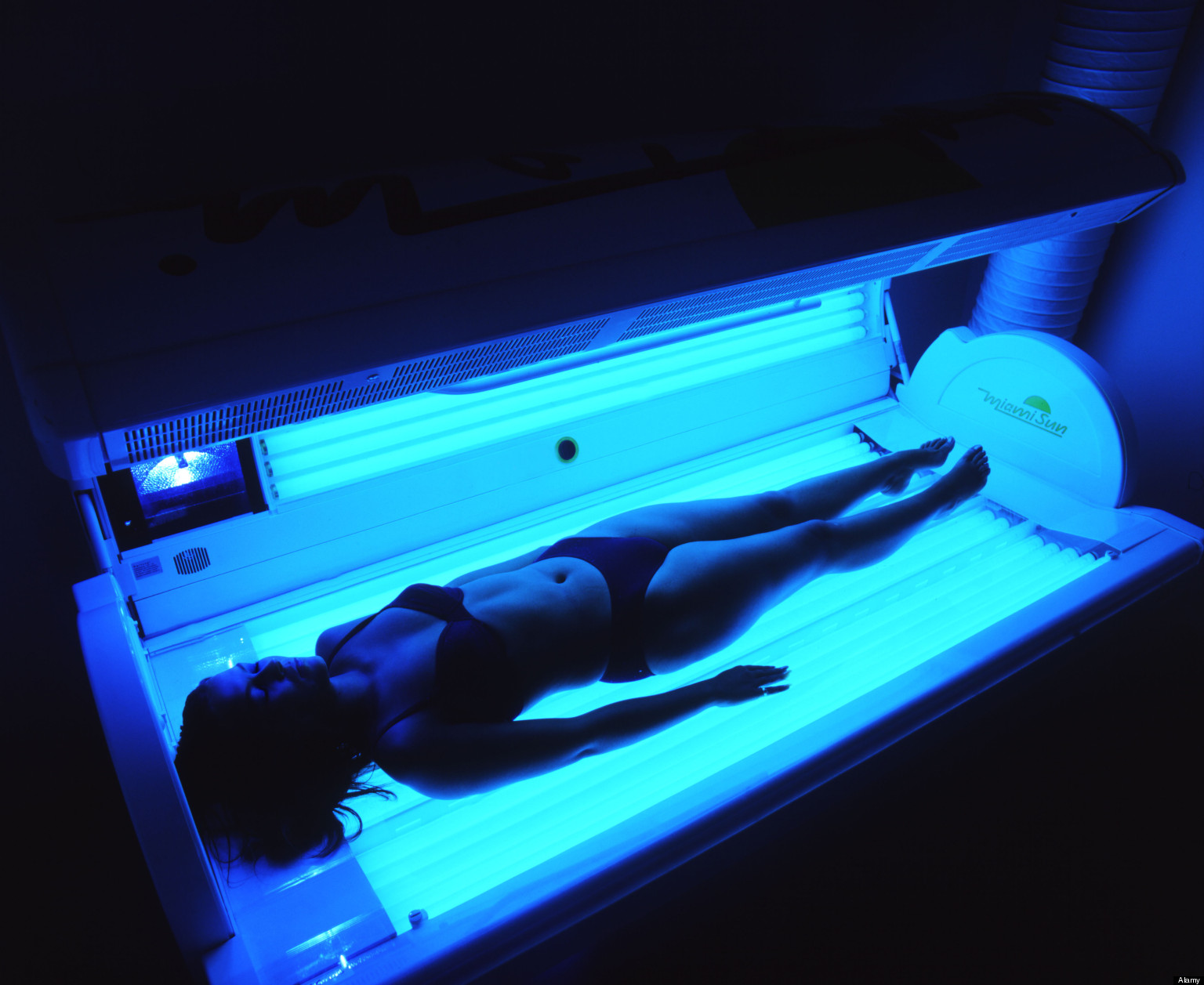 Girl lying on a sun bed