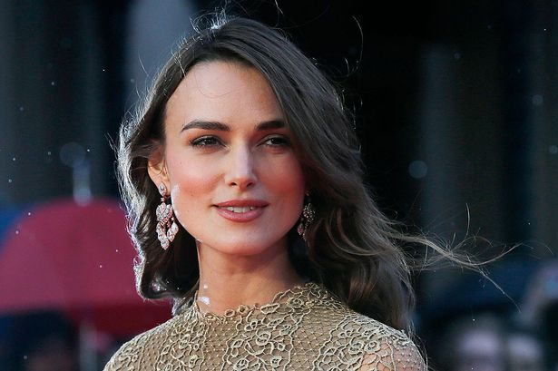 Actress-Keira-Knightley-poses-as-she-arrives-for-the-European-premiere-of-the-film-The-Imitation-Game-at-the-BFI
