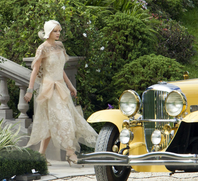 the great gatsby movie set - daisy with vintage yellow car via mylusciouslife