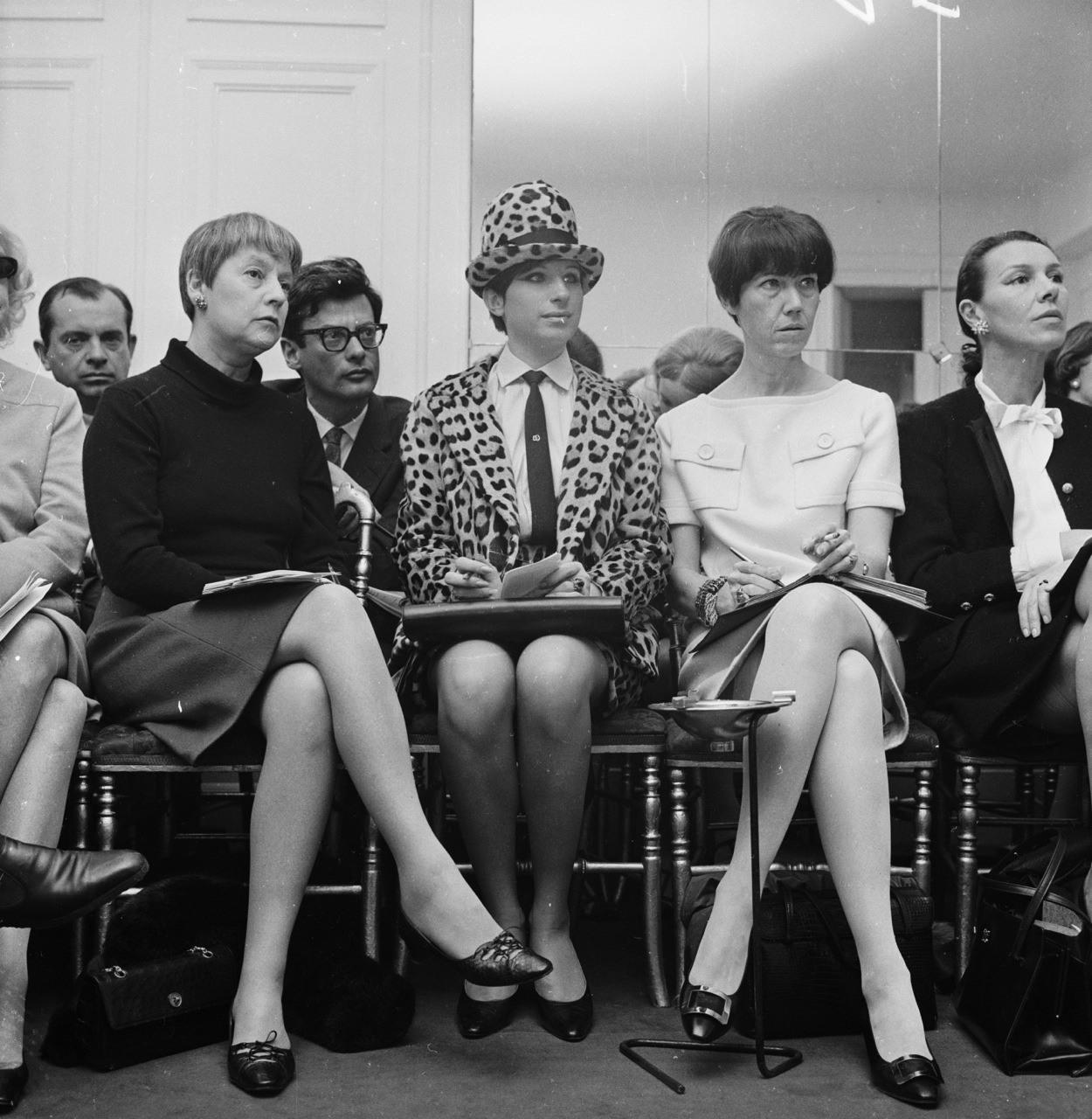 Paris, like Barbra Streisand sticking out like a sore thumb in leopard at a 1966 Chanel show