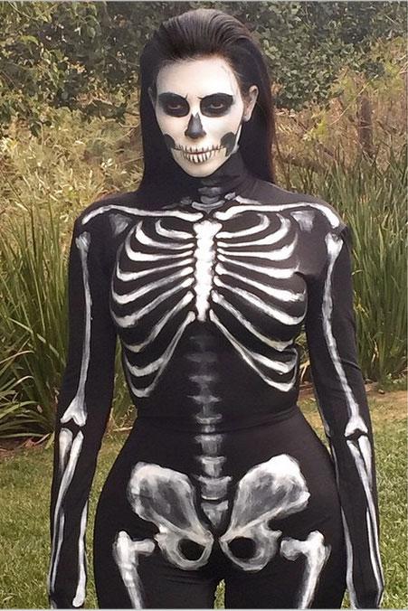 KIMK_halloween-clio_54ac5a59ed91e_-_elle-11-halloween-14-kim-kardashian-skeleton-v