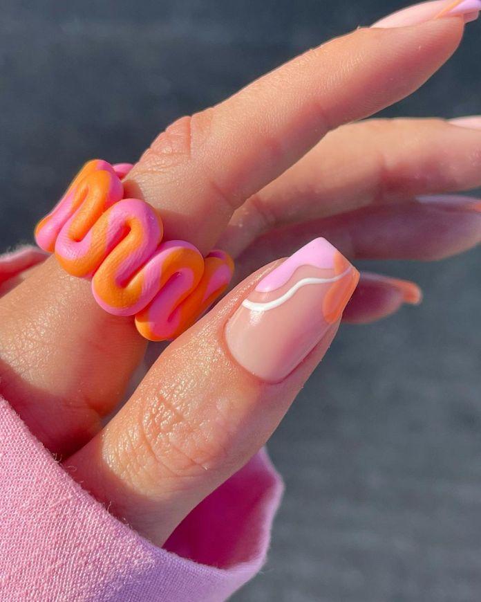 Cliomakeup-unghie-estive-semplici-2021-Swirl Nails-rosa-arancione