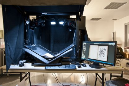 Specialized equipment is brought onsite to scan rare books into high-resolution digital files.