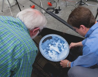 Nick and Andy adjust the cameo plate into position to be photographed
