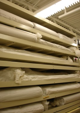 The rolls are now housed inside multiple layers of acid-free tissue paper, tied at each end with archival twill tape, and arranged by size and geography in an environmentally controlled space in the Library.