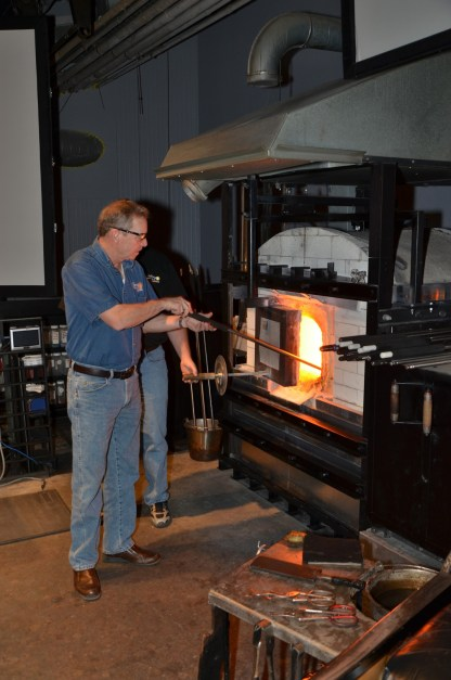 Don Pierce works on a piece on an old Hot Glass Show stage.