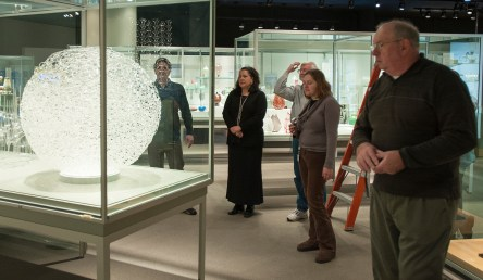 Tina Oldknow and team install Susan Plum's 'Woven Heaven Tangled Earth.'