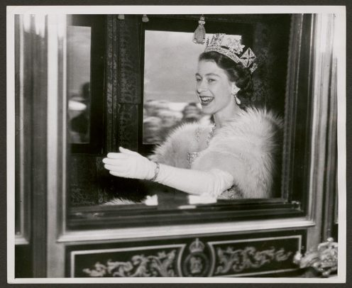 Princess Elizabeth waving from the royal carriage on her wedding day.