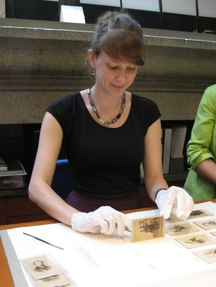 Intern Bonnie Hodul removing carte-de-visite photographs from their mounts at The Metropolitan Museum of Art in New York City, 2015.