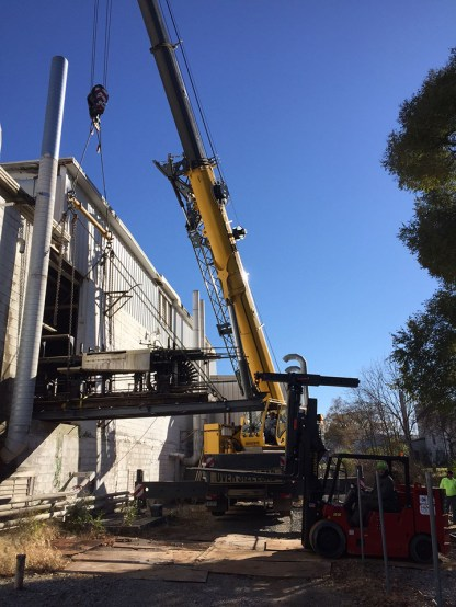 Section of the Ribbon Machine being craned out of the building