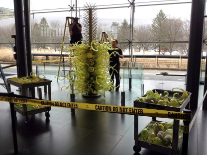 Chihuly's Fern Green Tower is re-assembled after cleaning.