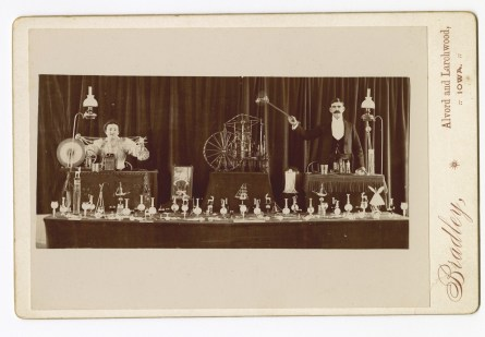 Photograph of itinerant glassworkers and their wares.
