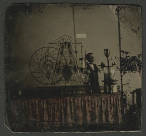 Tintype of glassworker and glass steam engine