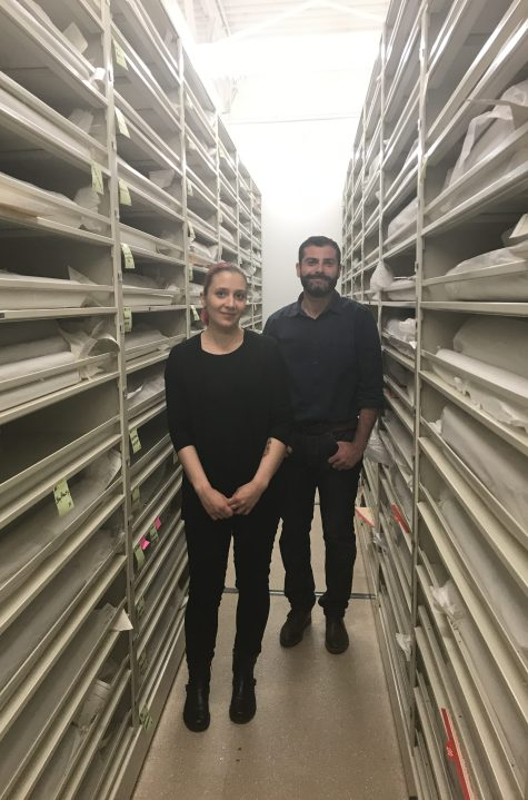Colette and Pascual pose between shelves filled with rolls of Whitefriars cartoons.