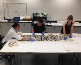Laura and Bonnie work with paper conservator Moya Dumville.