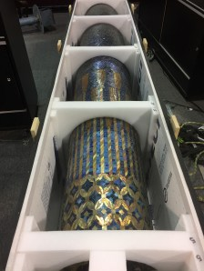 The large Tiffany mosaic column still in its crate.