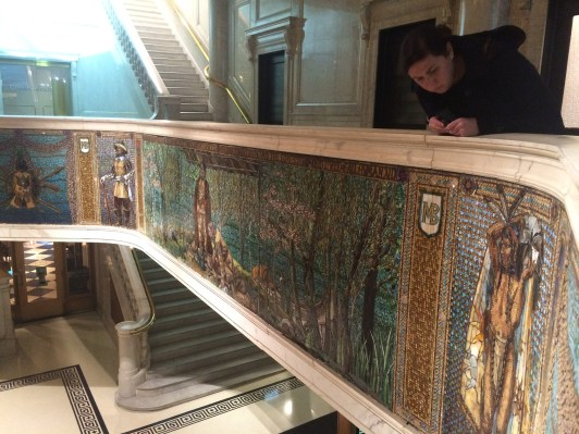 Co-curator Kelly Conway takes in the details of the mosaic at the Marquette Building in Chicago.