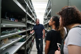 Collections manager Warren Bunn leads students on a tour of collections storage.