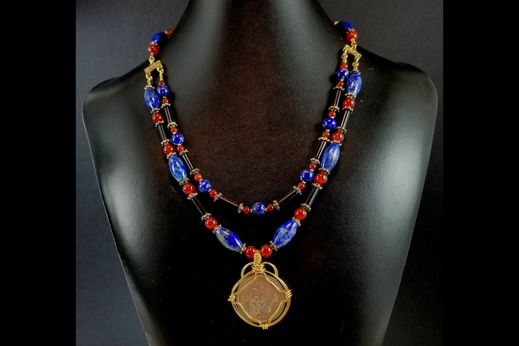 Necklace with Egyptian coin of Nefertiti with lapis lazuli and carnelian beads
