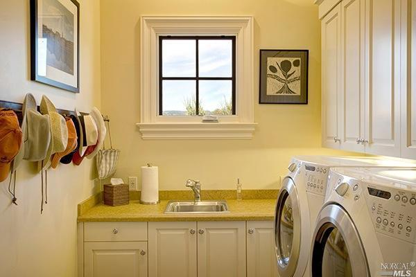 Natural light can make a big difference in a laundry room.  We love the square window in the laundry room of this St. Helena, California home.
