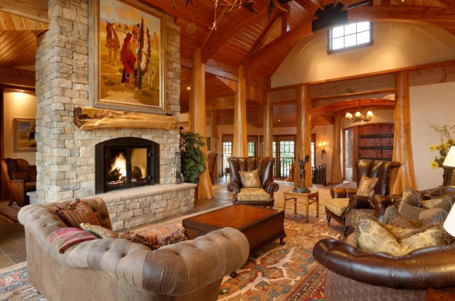 Soft leather seating, a roaring fireplace and soaring ceilings make this Glenwood Springs, CO lodge feel rustic and warm.