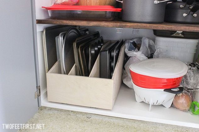 Store baking sheets and tins in a pull-out cabinet