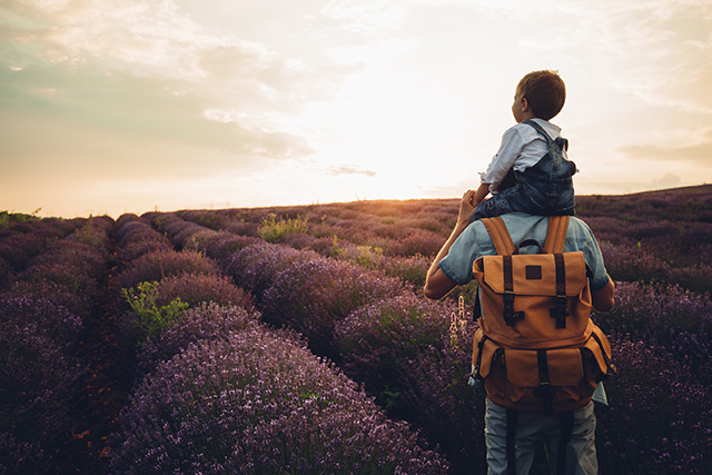 Photo of father and his son at the lavender field