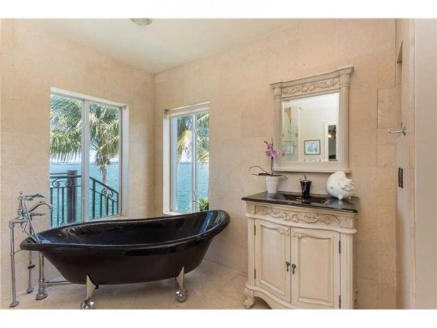 Clawfoot tubs may be associated with an antique look, but this bathtub in this Miami Beach bathroom is nothing but fresh. The black tub coupled with silver claw feet mixes old with new in a refreshing way. Located at 831 N Venetian Dr, Miami Beach, FL this waterfront property is listed at $4,390,000 by Jill Hertzberg with Coldwell Banker Residential Real Estate.
