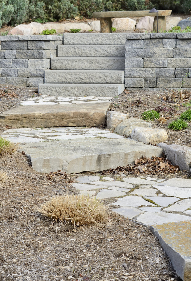 A professional landscaping job with stone path and stone steps.
