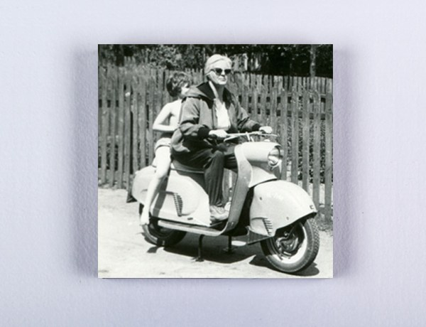 Canvas print of black & white image of woman on motorcycle with kid