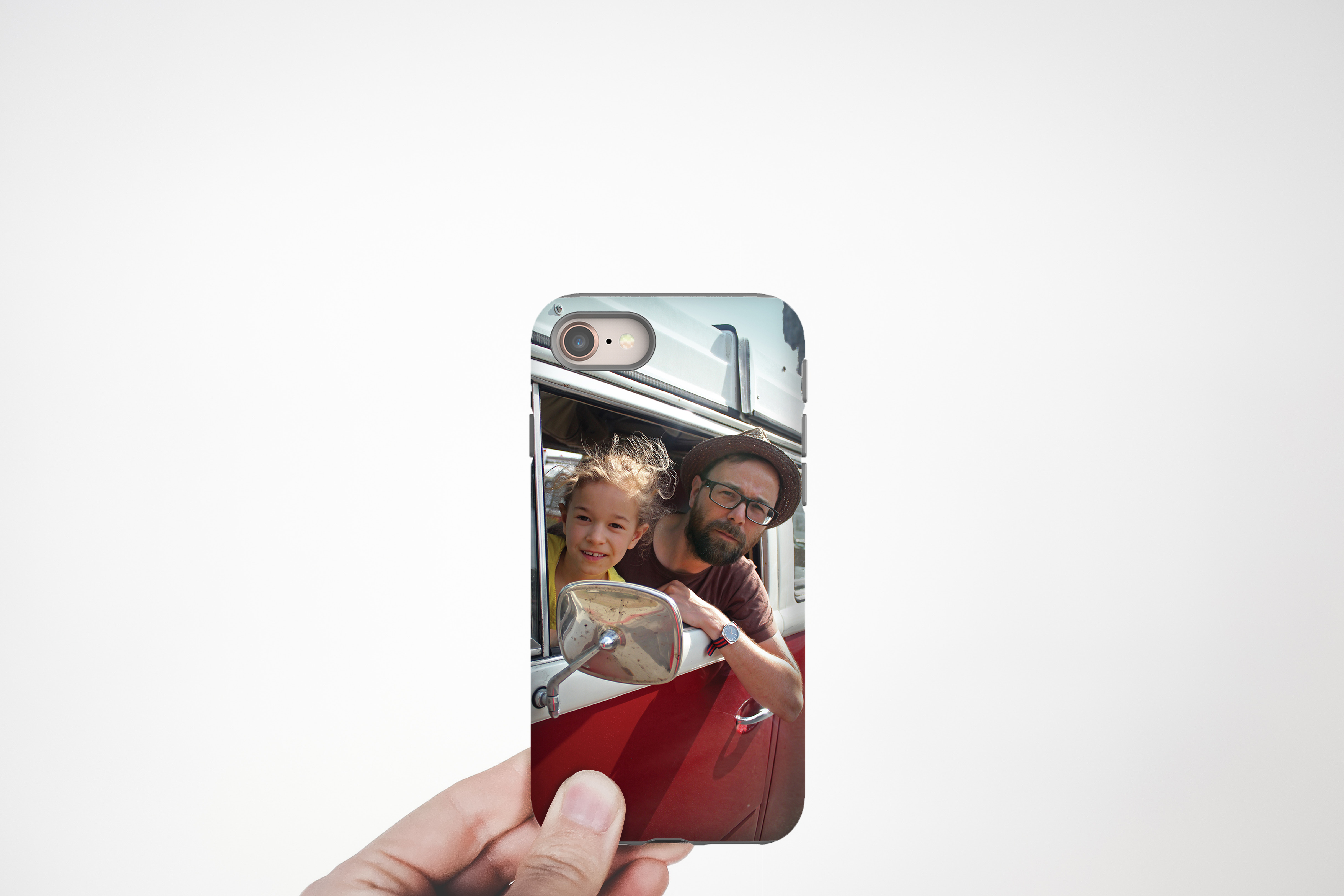 Hand holding custom iPhone case with photo of father and child