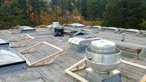 Curbs laid out on the roof, ready for retrofit.