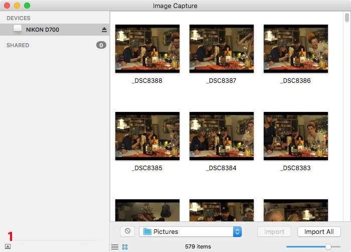 Start Image Capture en steek je kaartje in de kaartlezer of verbind je camera aan de Mac. Klik op het vakje met het pijltje linksonder in het dialoogvenster (1).
