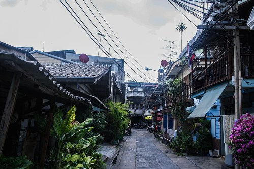 As much as I love this photo, it shows the limits of shooting in JPEG. (See the sky?) Often, down this kind of alley, you will find laundry shops. Taken in Bangkok on Dec. 4, 2015.