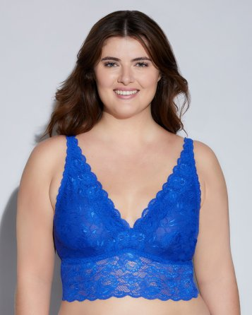 Woman wearing elongated waist bralette with plunging neckline and longline band.