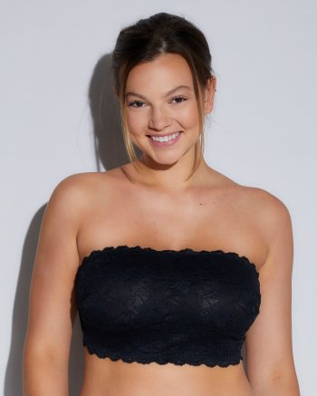 Woman wearing strapless bralette with support elements.
