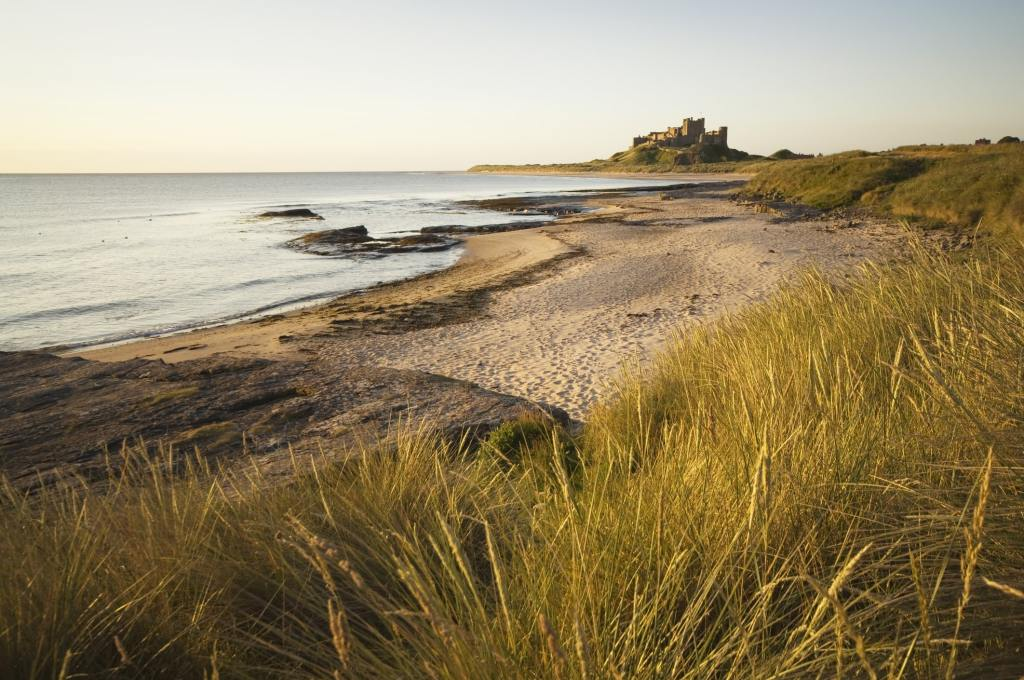 Bamburgh beach with castle in background