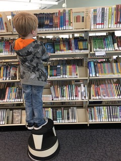 Looking at books in the library