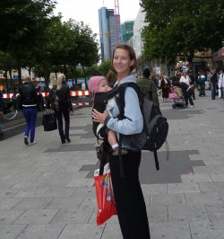 Mom wearing baby while traveling