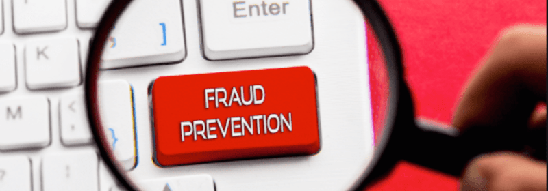 """A snapshot of a keyboard with a large red key marked """"fraud prevention"""""""