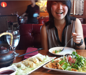 Yija and Alex eating Sushi