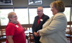 """Joyce Loveday, Clover Park Technical College interim president, greets Judy MacDougall, who worked at CPTC for 30 years, during the CPTC Retiree Luncheon, June 7, 2016. """"Ever since I retired I come because it's nice to see everybody and hear what's going on,"""" MacDougall said."""