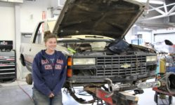 Ericka DeBoer is working on customizing her Chevrolet Blazer, cutting off the back to turn it into a truck and changing the axle to make it more conducive to off-road driving.