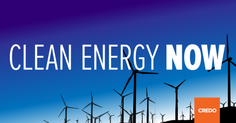 Clean Energy Now Written on a blue background with wind energy in the distance and the CREDO logo in the right hand corner