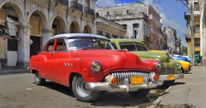 Old american classic cars parked in a street of havana city